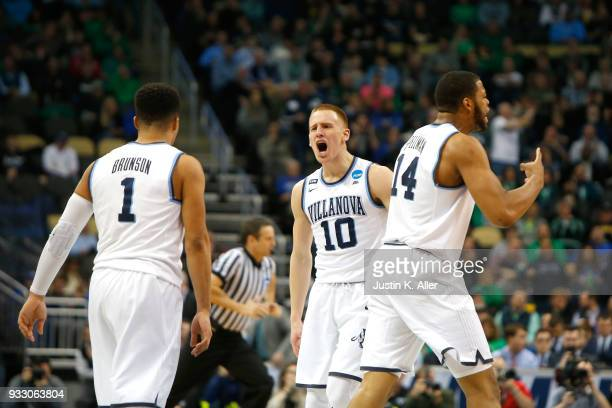 Donte DiVincenzo of the Villanova Wildcats celebrates with his teammates Jalen Brunson and Omari Spellman against the Alabama Crimson Tide during the...