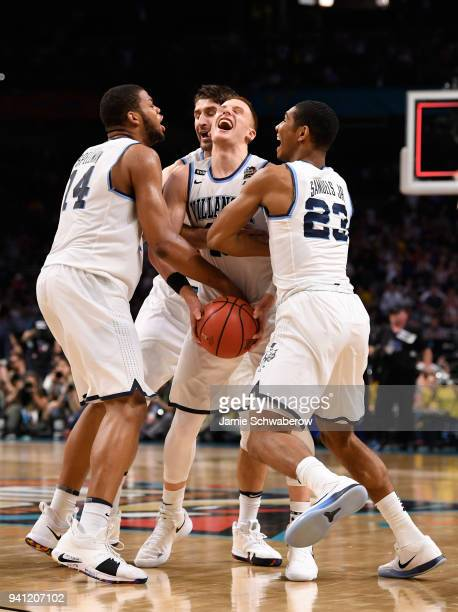 Donte DiVincenzo of the Villanova Wildcats celebrates with Omari Spellman and Jermaine Samuels after the 2018 NCAA Photos via Getty Images Men's...