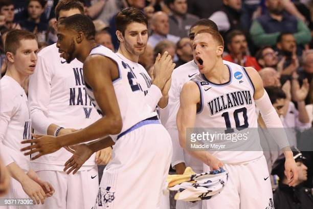 Donte DiVincenzo of the Villanova Wildcats celebrates with teammates on the bench during the second half against the West Virginia Mountaineers in...