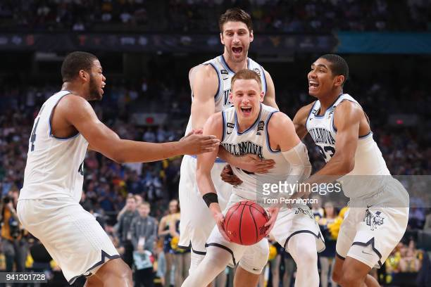 Donte DiVincenzo of the Villanova Wildcats celebrates with teammates after defeating the Michigan Wolverines during the 2018 NCAA Men's Final Four...