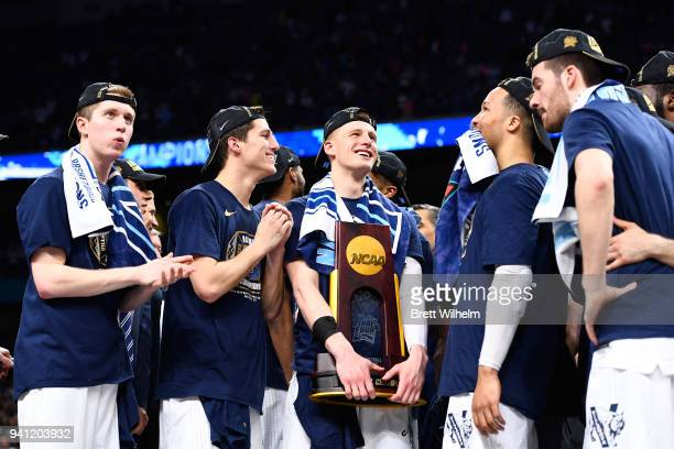 Donte DiVincenzo of the Villanova Wildcats celebrates with the trophy after the 2018 NCAA Photos via Getty Images Men's Final Four National...