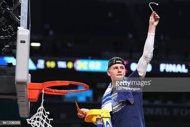 Donte DiVincenzo of the Villanova Wildcats cuts down the net after defeating the Michigan Wolverines during the 2018 NCAA Men's Final Four National...