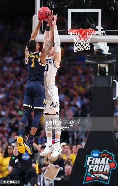 Donte DiVincenzo of the Villanova Wildcats defends Charles Matthews of the Michigan Wolverines in the second half during the 2018 NCAA Men's Final...