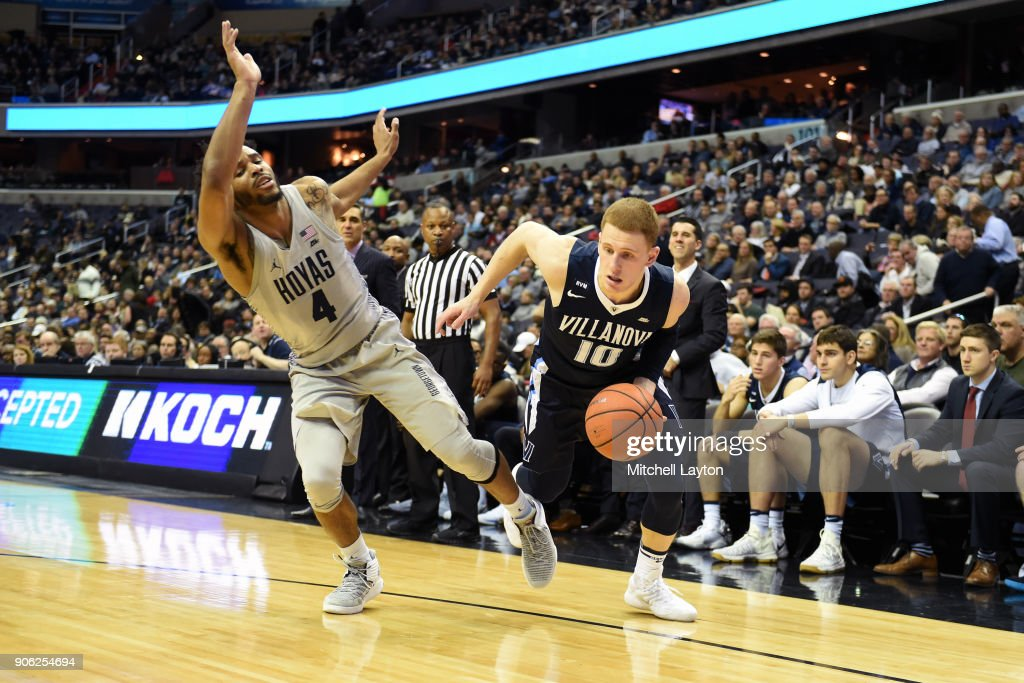 Donte DiVincenzo #10 of the Villanova Wildcats dribbles around Jagan Mosely #4 of the Georgetown Hoyas during a college basketball game at the Capital One Arena on January 17, 2018 in Washington, DC.
