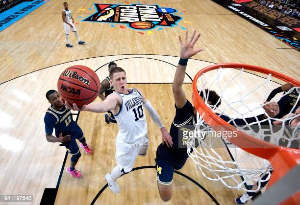 Donte DiVincenzo of the Villanova Wildcats drives to the basket against Isaiah Livers of the Michigan Wolverines in the first half during the 2018...