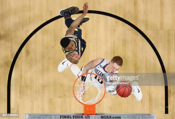 Donte DiVincenzo of the Villanova Wildcats drives to the basket against Charles Matthews of the Michigan Wolverines in the second half during the...