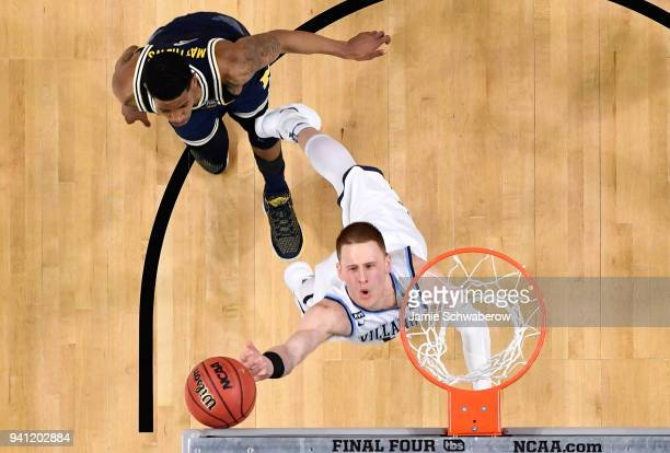Donte DiVincenzo of the Villanova Wildcats drives to the basket against the Michigan Wolverines during the second half of the 2018 NCAA Photos via...