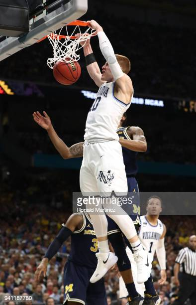 Donte DiVincenzo of the Villanova Wildcats goes up for a dunk in the first half against the Michigan Wolverines during the 2018 NCAA Men's Final Four...