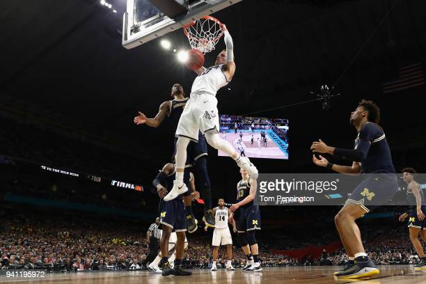 Donte DiVincenzo of the Villanova Wildcats goes up for a dunk in the first half against Charles Matthews of the Michigan Wolverines during the 2018...