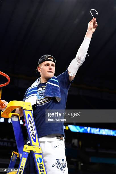Donte DiVincenzo of the Villanova Wildcats holds a piece of the net after the 2018 NCAA Photos via Getty Images Men's Final Four National...