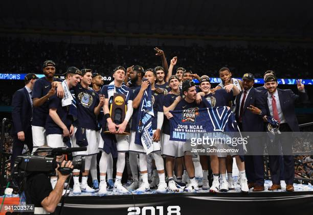 Donte DiVincenzo of the Villanova Wildcats holds the trophy on stage after the 2018 NCAA Photos via Getty Images Men's Final Four National...