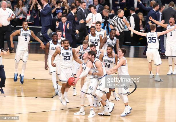 Donte DiVincenzo of the Villanova Wildcats is met by teammates after the 2018 NCAA Photos via Getty Images Men's Final Four National Championship...