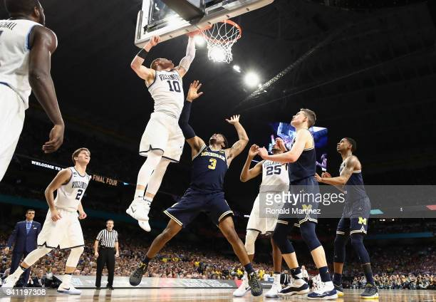 Donte DiVincenzo of the Villanova Wildcats shoots against Zavier Simpson of the Michigan Wolverines in the first half during the 2018 NCAA Men's...
