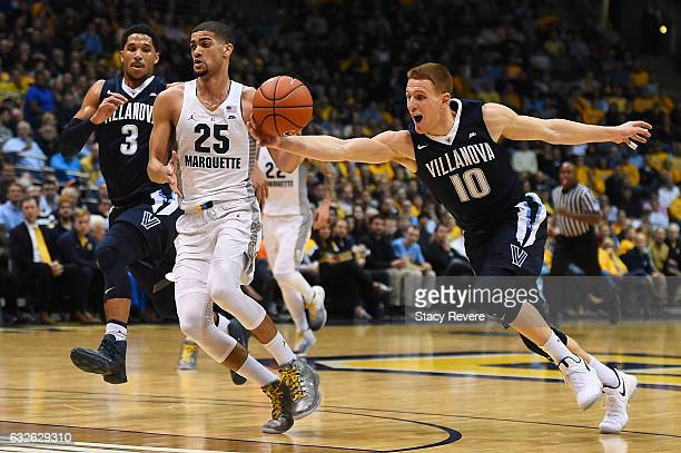 Donte DiVincenzo of the Villanova Wildcats steals the ball from Haanif Cheatham of the Marquette Golden Eagles during the second half of a game at...