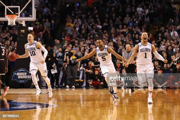 Donte DiVincenzo Phil Booth and Jalen Brunson of the Villanova Wildcats celebrate defeating the Texas Tech Red Raiders 7159 in the 2018 NCAA Men's...