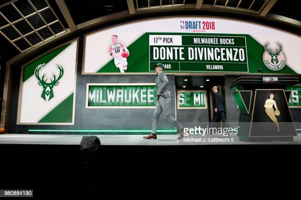 Donte DiVincenzo walks across the stage after being selected seventeenth by the Milwaukee Bucks on June 21 2018 at Barclays Center during the 2018...