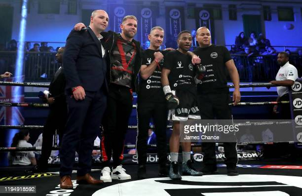 Donte Dixon celebrates victory over Vladislavs Davidaits with his team and his manager Billy Joe Saunders after the SuperFeatherweight fight between...