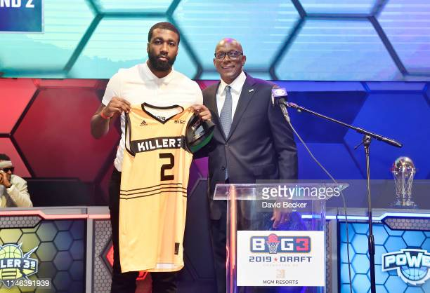 Donte Greene poses with BIG3 Commissioner Clyde Drexler after being drafted at by the Killer 3's in the second round during the BIG3 Draft at the...