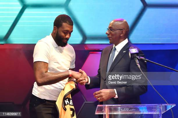Donte Greene shakes hands with BIG3 Commissioner Clyde Drexler after being drafted at by the Killer 3's in the second round during the BIG3 Draft at...