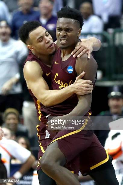 Donte Ingram and Marques Townes of the Loyola Ramblers celebrate after Ingram makes a gamewinning three pointer against the Miami Hurricanes in the...