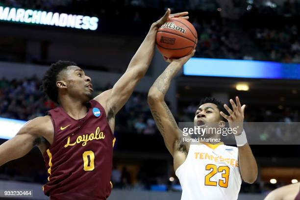 Donte Ingram of the Loyola Ramblers blocks a shot attempt by Jordan Bowden of the Tennessee Volunteers in the second half during the second round of...