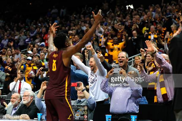 Donte Ingram of the Loyola Ramblers celebrates after defeating the Kansas State Wildcats during the 2018 NCAA Men's Basketball Tournament South...