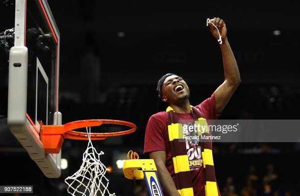 Donte Ingram of the Loyola Ramblers celebrates by cutting down the net after defeating the Kansas State Wildcats during the 2018 NCAA Men's...