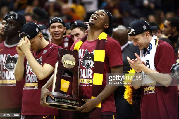 Donte Ingram of the Loyola Ramblers celebrates with the trophy after defeating the Kansas State Wildcats during the 2018 NCAA Men's Basketball...