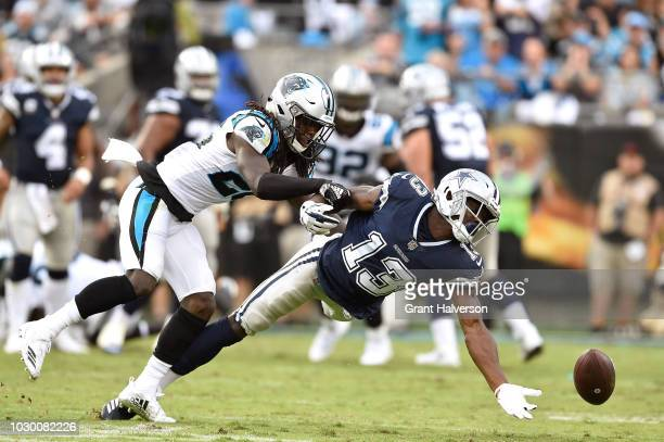 Donte Jackson of the Carolina Panthers is called for pass interference as he defends Michael Gallup of the Dallas Cowboys during their game at Bank...