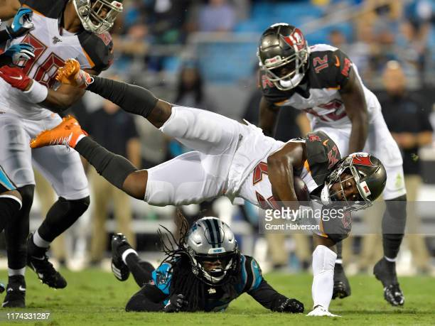 Donte Jackson of the Carolina Panthers tackles Peyton Barber of the Tampa Bay Buccaneers during the second quarter of their game at Bank of America...