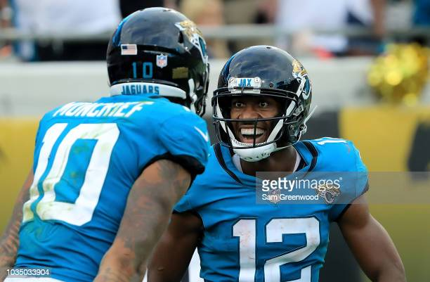 Donte Moncrief and Dede Westbrook of the Jacksonville Jaguars celebrate a touchdown during the game against the New England Patriots at TIAA Bank...