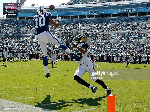 Donte Moncrief of the Indianapolis Colts catches a pass inside the 10-yard line over defender Demetrius McCray of the Jacksonville Jaguars during the...