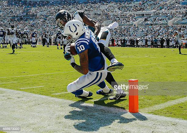 Donte Moncrief of the Indianapolis Colts catches a pass inside the 10yard line over defender Demetrius McCray of the Jacksonville Jaguars during the...
