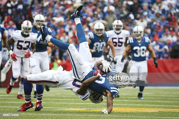 Donte Moncrief of the Indianapolis Colts is tackled by Bacarri Rambo of the Buffalo Bills during the first half at Ralph Wilson Stadium on September...