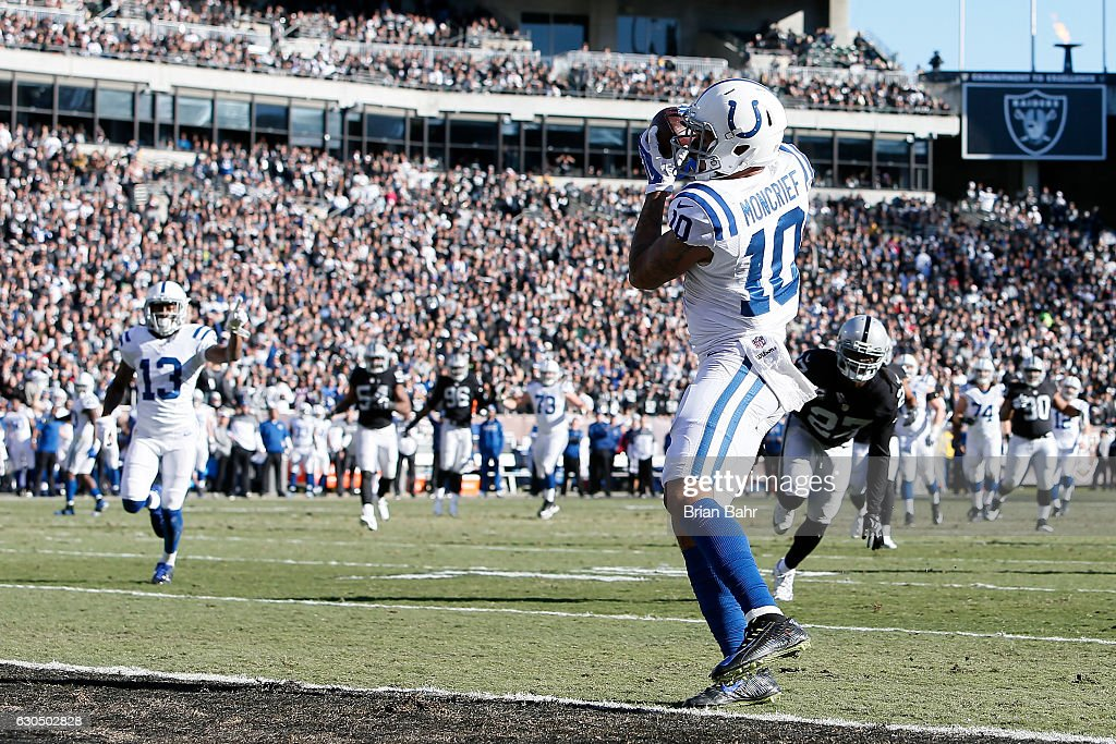 Donte Moncrief #10 of the Indianapolis Colts scores on a 24-yard touchdown catch against the Oakland Raiders during their NFL game at Oakland Alameda Coliseum on December 24, 2016 in Oakland, California.