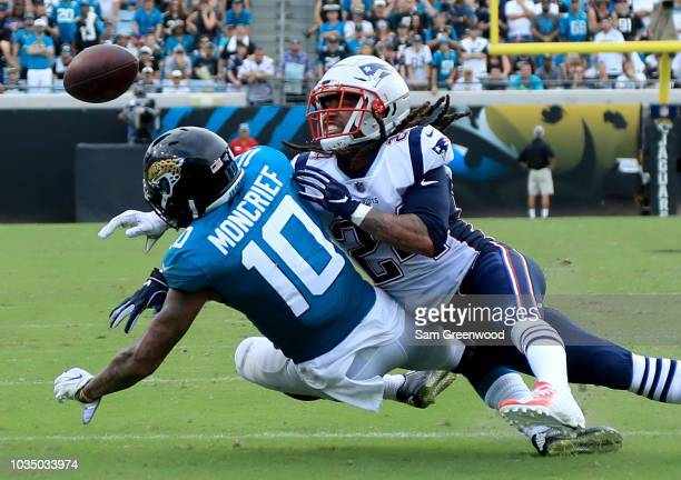 Donte Moncrief of the Jacksonville Jaguars attempts a reception against Stephon Gilmore of the New England Patriots during the game at TIAA Bank...