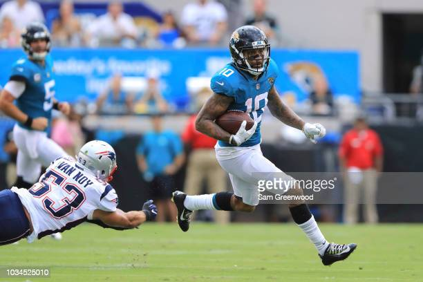 Donte Moncrief of the Jacksonville Jaguars avoids a tackle from Kyle Van Noy of the New England Patriots in the first half at TIAA Bank Field on...