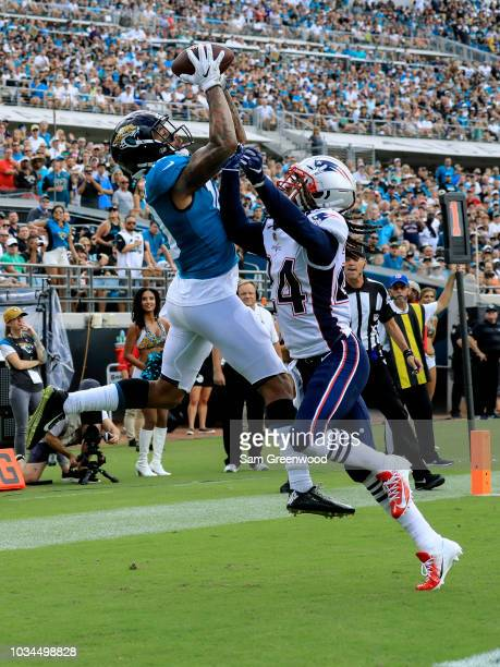 Donte Moncrief of the Jacksonville Jaguars goes up for a touchdown catch over Stephon Gilmore of the New England Patriots at TIAA Bank Field on...