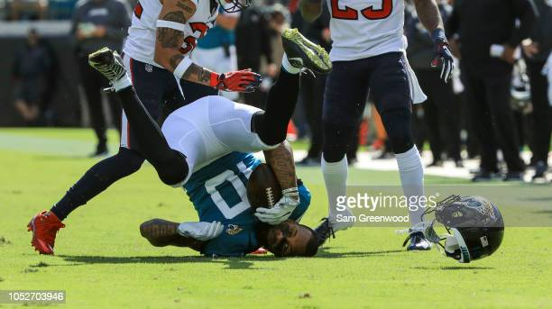 Donte Moncrief of the Jacksonville Jaguars has his helmet knocked off while being tackled during the second half against the Houston Texans at TIAA...