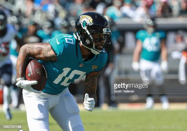 Donte Moncrief of the Jacksonville Jaguars runs for yards after catch during the second half against the Houston Texans at TIAA Bank Field on October...