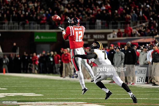 Donte Moncrief of the Ole Miss Rebels catches a pass in front of Randy Ponder of the Missouri Tigers during a game at Vaught-Hemingway Stadium on...