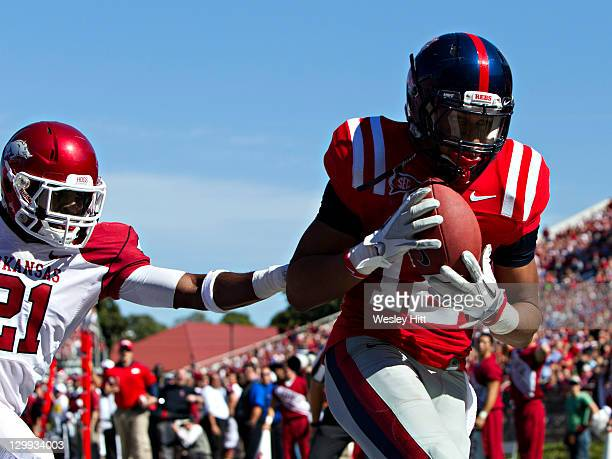 Donte Moncrief of the Ole Miss Rebels catches a touchdown pass over Darius Winston of the Arkansas Razorbacks at VaughtHemingway Stadium on October...