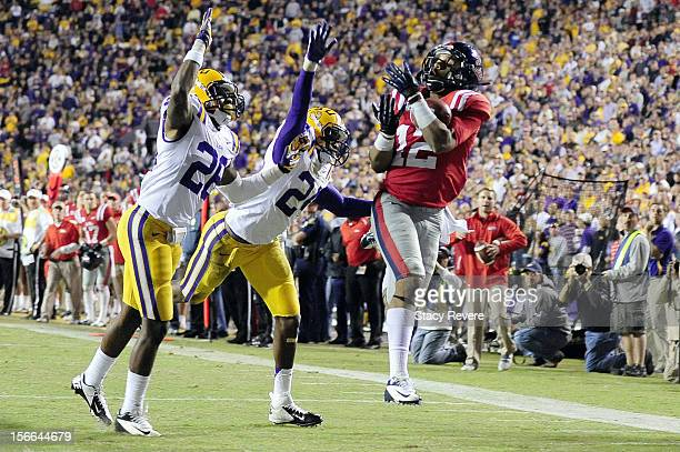 Donte Moncrief of the Ole Miss Rebels catches a touchdown pass over Jalen Mills and Tharold Simon of the LSU Tigers during a game at Tiger Stadium on...