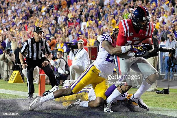 Donte Moncrief of the Ole Miss Rebels scores a touchdown in front of Ronald Martin of the LSU Tigers during a game at Tiger Stadium on November 17,...