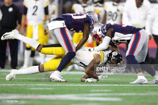 Donte Moncrief of the Pittsburgh Steelers is tackled by the New England Patriots during the second half at Gillette Stadium on September 08, 2019 in...