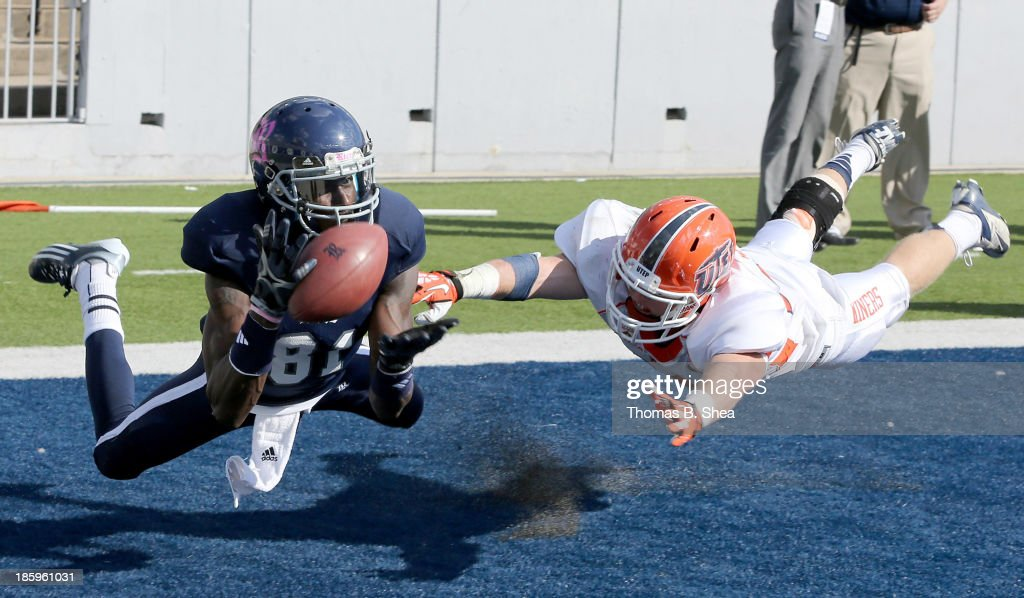 Donte Moore #81 of the Rice Owls drops the pass while being covered by Wesley Miller #13 of the UTEP Miners on October 26, 2013 at Rice Stadium in Houston, Texas.