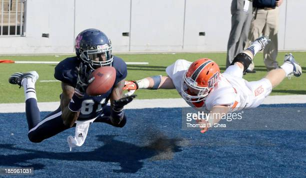 Donte Moore of the Rice Owls drops the pass while being covered by Wesley Miller of the UTEP Miners on October 26 2013 at Rice Stadium in Houston...