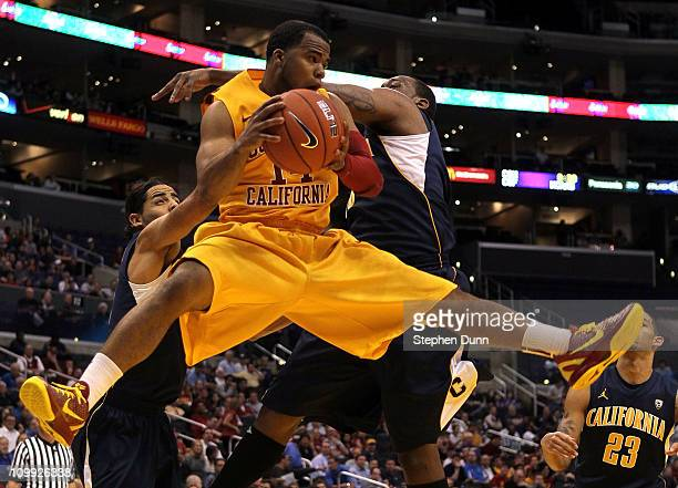 Donte Smith of the USC Trojans looks to pass the ball against Markhuri Sanders-Frison of the California Golden Bears in the second half in the...