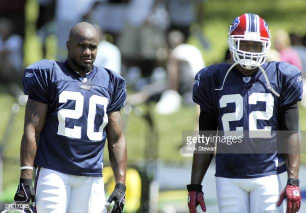 Donte Whitner and Nate Clements of the Buffalo Bills watch practice during training camp on August 9 2006 at St John Fisher College in Pittsford New...
