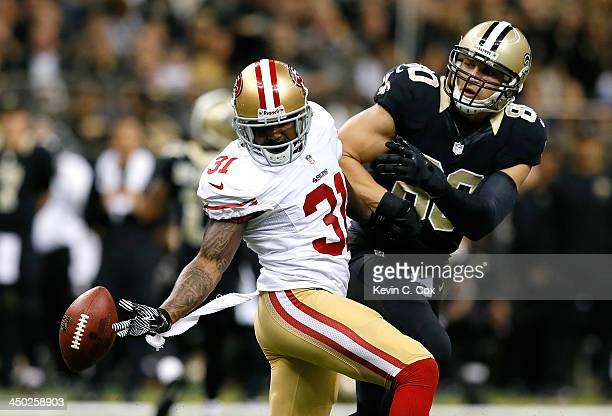 Donte Whitner of the San Francisco 49ers nearly picks off this reception intended for Jimmy Graham of the New Orleans Saints at MercedesBenz...